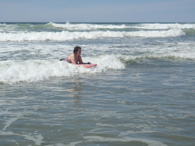 I thoroughly enjoy body boarding, but as KJ may care to notice, I am quite expressionless in this picture.  Again.