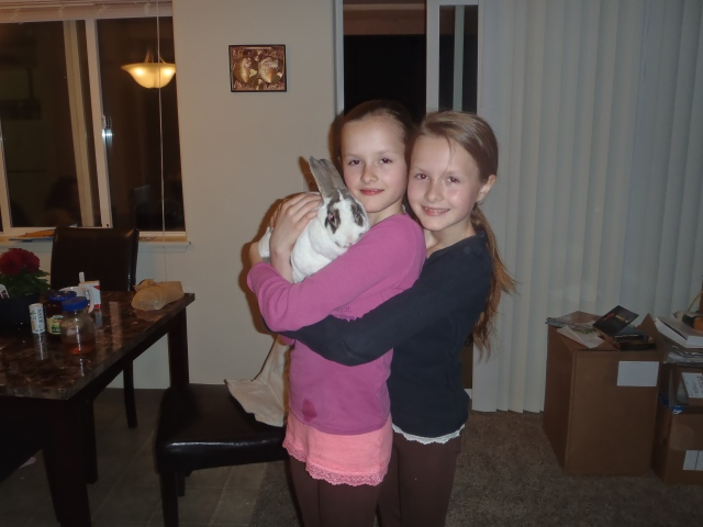 My little sisters are freakin' adorable, and their rabbit is cute but so fat that she can hold a carrot in her chins to eat it.